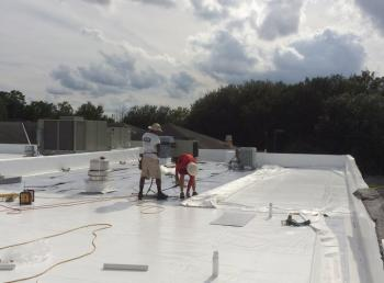 Dubo Roofing installing a commercial roof in jacksonville, florida