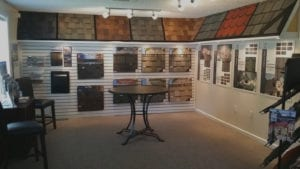 image shows the DUBO showroom with different colors and styles of roof materials