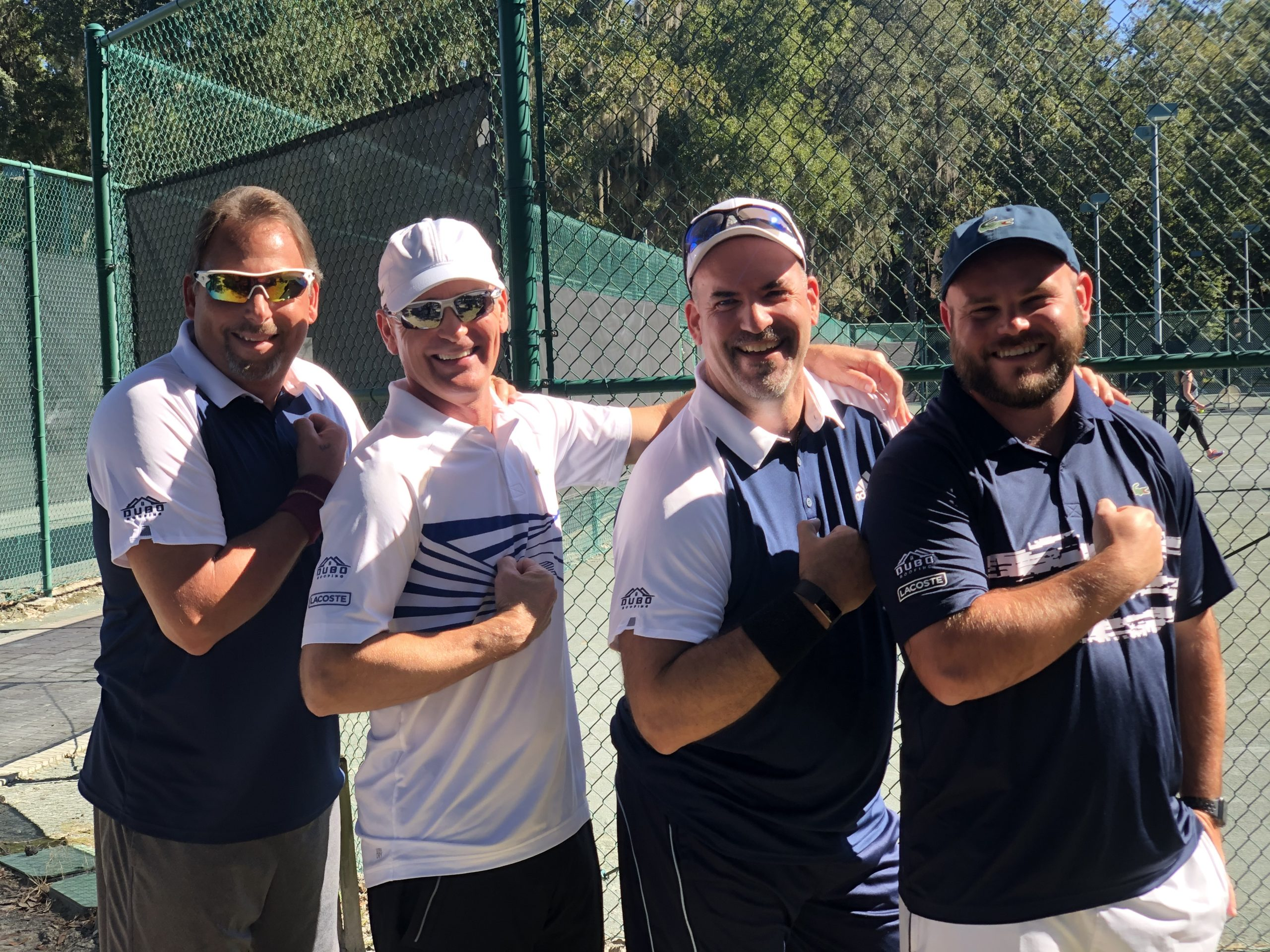 photo of 4 men on tennis court