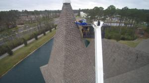 photo  of Dubo staff repairing roof on Grace Anglican Churchh