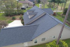 This is a photo of a completed roof for a home we did on Eagle Harbor Pkwy. The shingle color is Moire Black