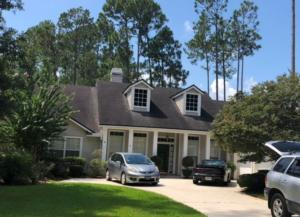 """This is a """"Before"""" photo of a home we did on Eagle Harbor Pkwy. The shingle color is Moire Black"""