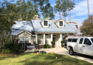 This is a photo of work in progress on a home we did on Eagle Harbor Pkwy. The shingle color is Moire Black